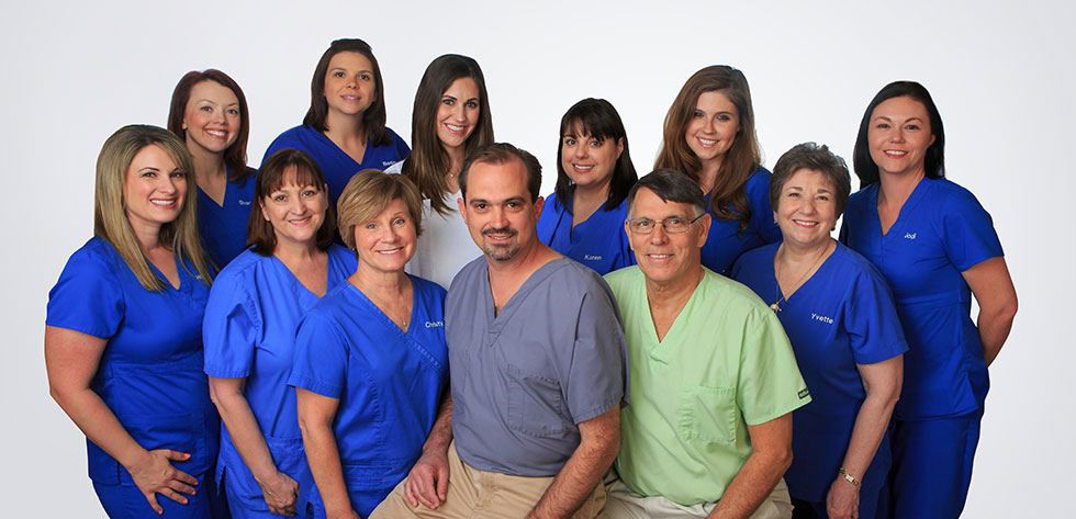 Drs. Plaisance and deJong with dental team near Metairie