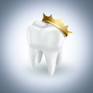 white tooth wearing golden crown